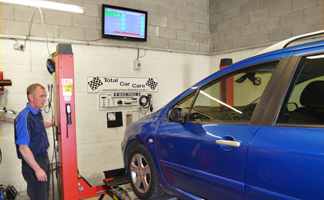 MOT Tester lifting car for inpsection during Daventry MOT